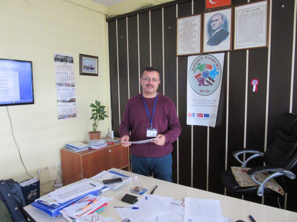 67. Ali Çetinkaya Ortaokulu school's headmaster with the certificates