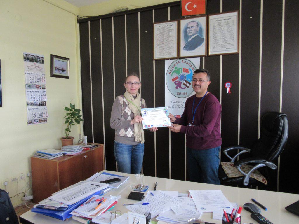 69. Ali Çetinkaya Ortaokulu school's headmaster giving the certificate to Latvian coordinator