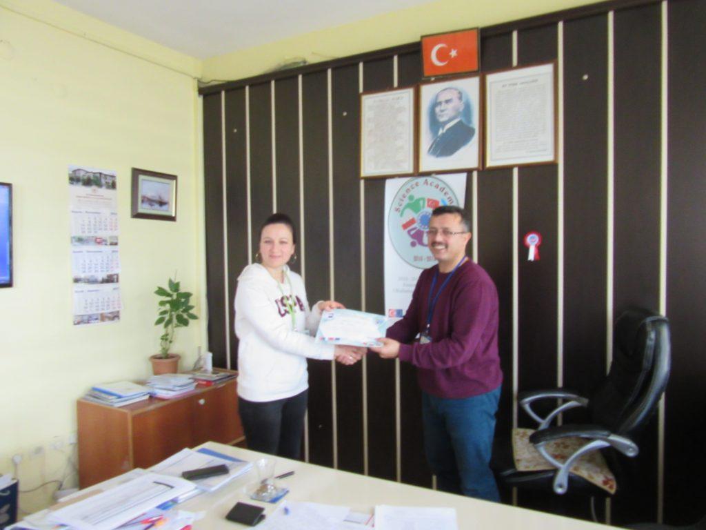 70. Ali Çetinkaya Ortaokulu school's headmaster giving the certificate to Turkish coordinator